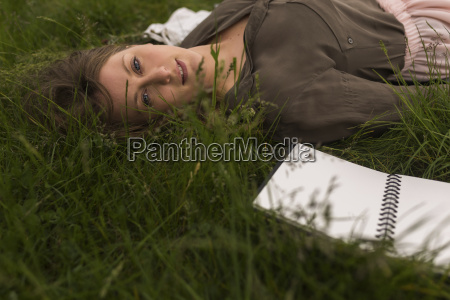 portrait of daydreaming woman lying on