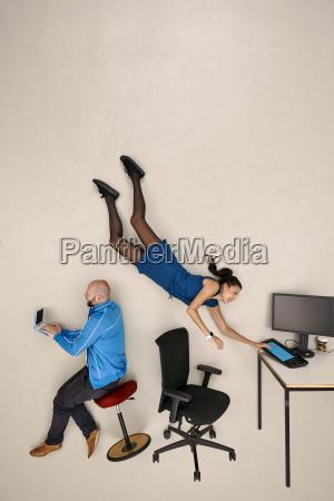 business woman flying towards office desk