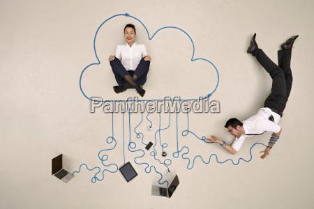 businesswoman meditating in cloud businessman tangled