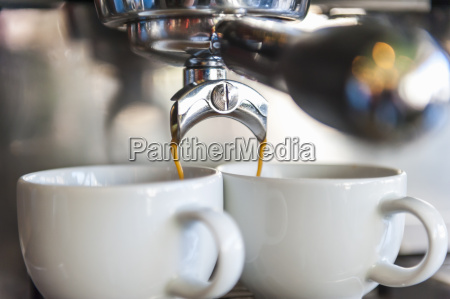 coffee machine preparing two cups of