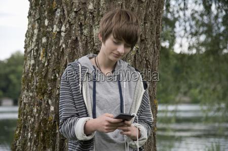 teenage girl standing in front of