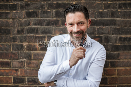 portrait of smiling businessman leaning at