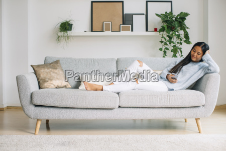 young woman relaxing on couch in