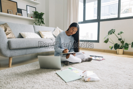 young woman sitting on floor in
