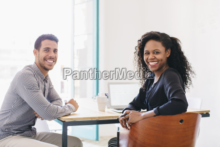 young businessman and woman working together