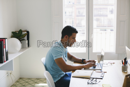 young man working in office using