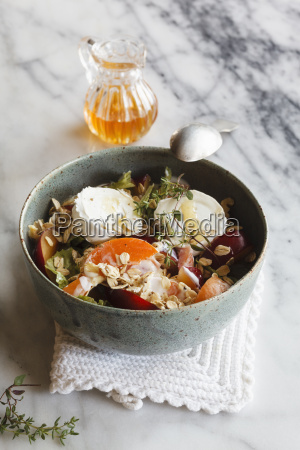 hearty oat flakes bowl with fruits