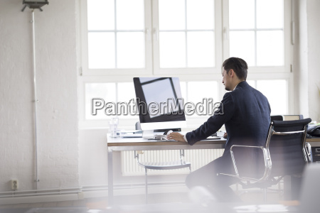 businessman sitting in office working on