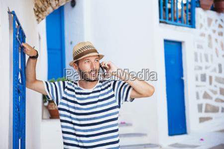greece amorgos island young man talking