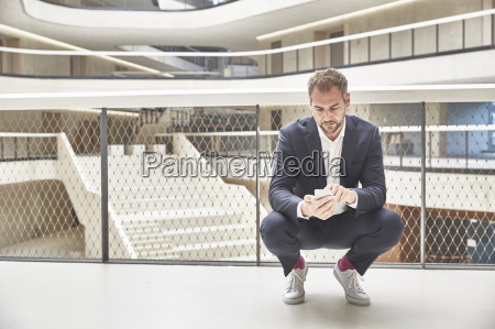 businessman in office building looking at