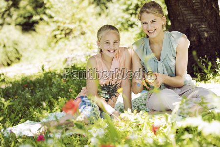 portrait of smiling girl and young
