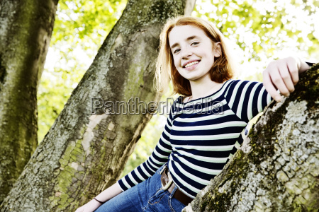 portrait of smiling girl leaning against