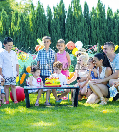 children celebrating birthday party with friends