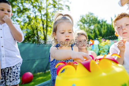 children celebrating birthday party in the