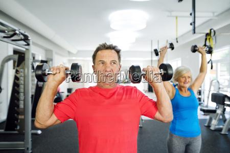 senior man and mature woman working
