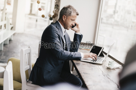 businessman sitting in cafe working