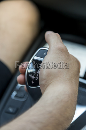 mans hand on gearshift close up