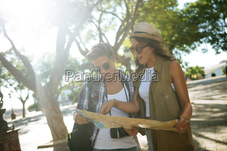 young couple looking at city map