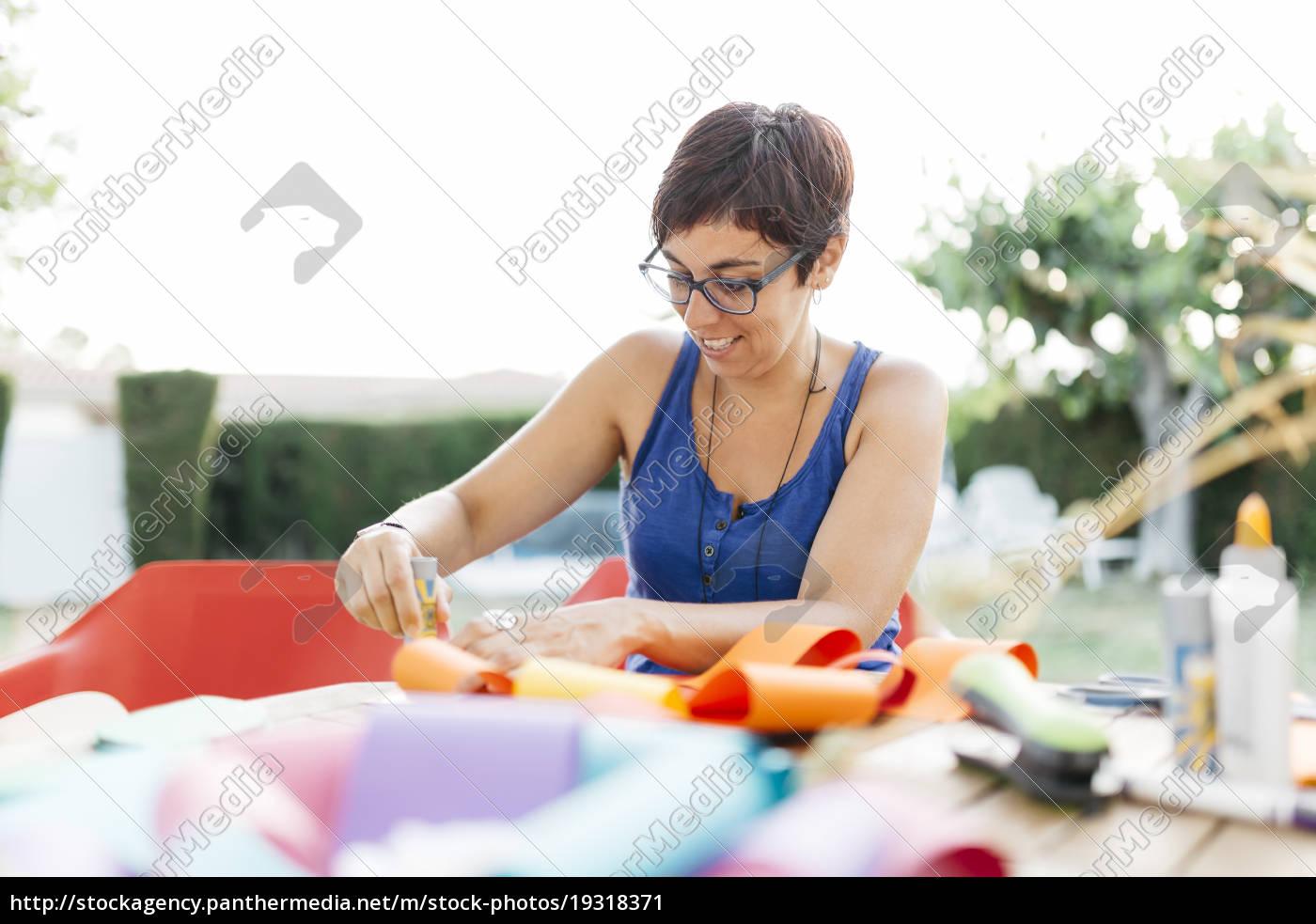 woman, doing, handicrafts, at, garden, table - 19318371