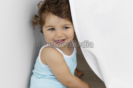portrait of baby girl playing hide