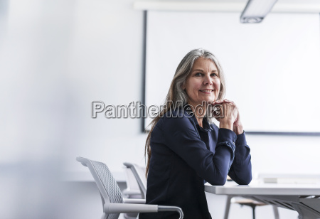portrait of smiling senior businesswoman in