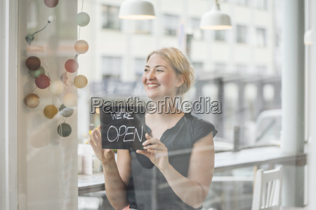 smiling woman in a cafe attaching