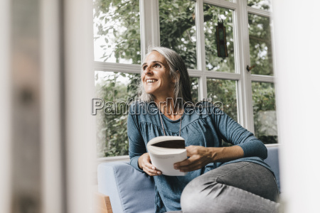 smiling woman with book sitting on