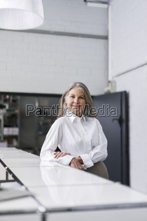 portrait of smiling senior businessswoman