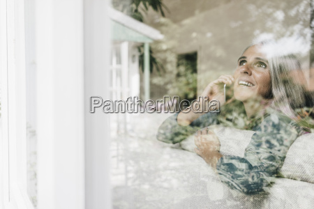 smiling woman on the phone sitting