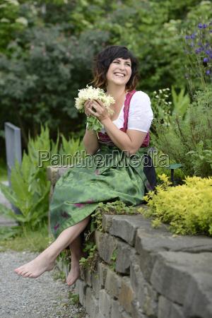 germany bavaria smiling woman wearing dirndl