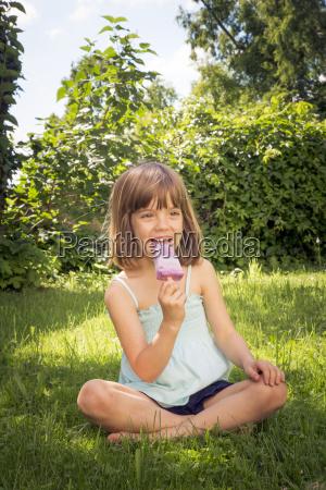 portrait of happy little girl sitting