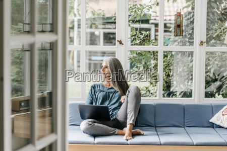 woman sitting on lounge in winter