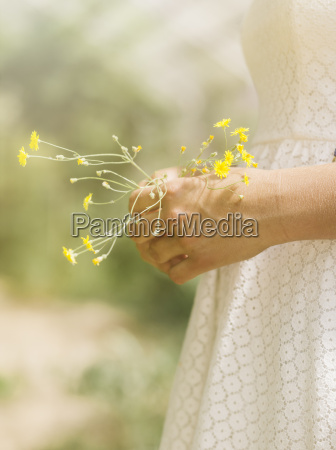 close up of woman holding flowers