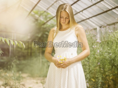 blond young woman in white dress