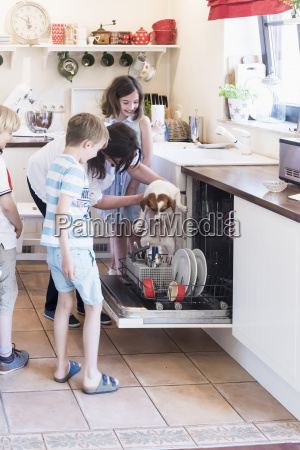 family and dog in kitchen at