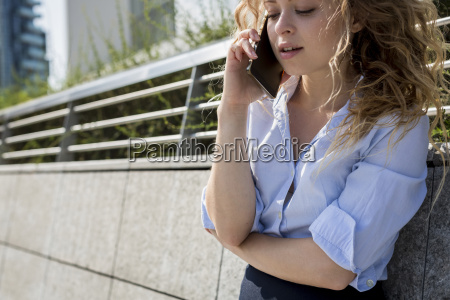 businesswoman on cell phone outdoors