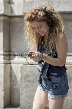 smiling young woman with headphones text