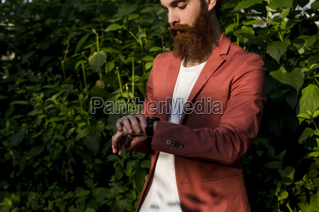 fashionable young man with full beard