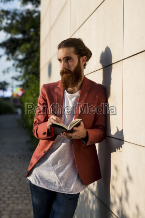fashionable young man with notebook