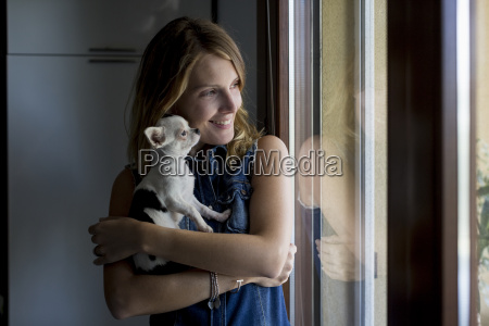 smiling woman with dog on her