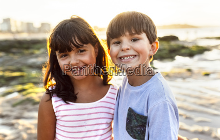 portrait of two smiling kids on