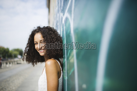portrait of smiling young woman leaning