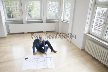 man looking at construction plan in