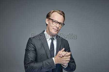 portrait of smart businessman rubbing his