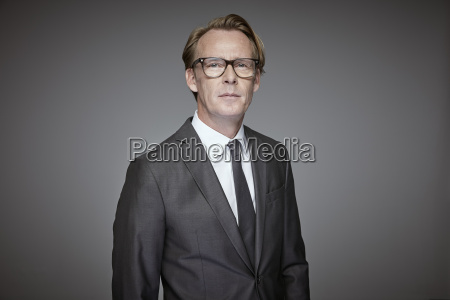 portrait of serious businessman in front