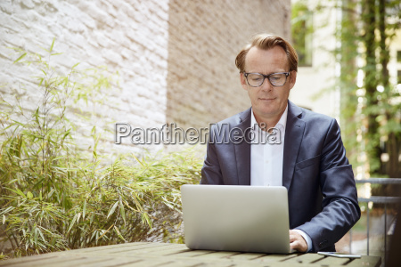businessman sitting at table in a