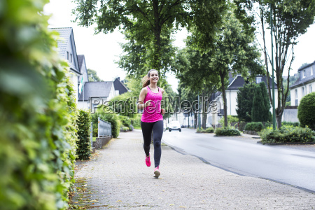 smiling young woman jogging