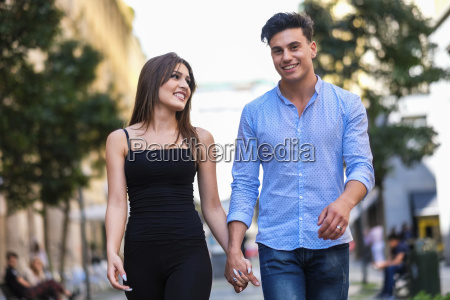 happy young couple walking hand in