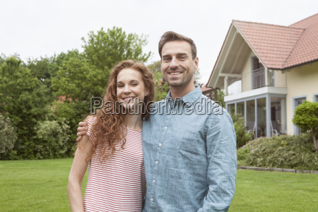 portrait of smiling couple in garden
