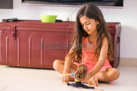 portrait of little girl sitting on